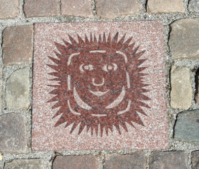 "A street stone on the Odense ""play route""."
